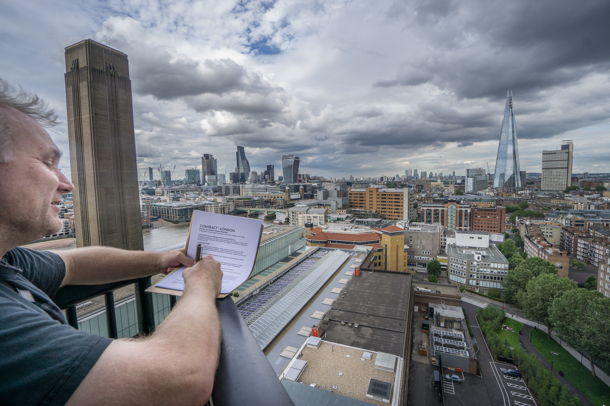 George, London author signing his contract high above London on the new Switch House building at the Tate Modern.