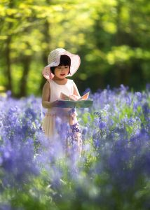 Sophia Yu amongst April bluebells in the Yorkshire Dales.
