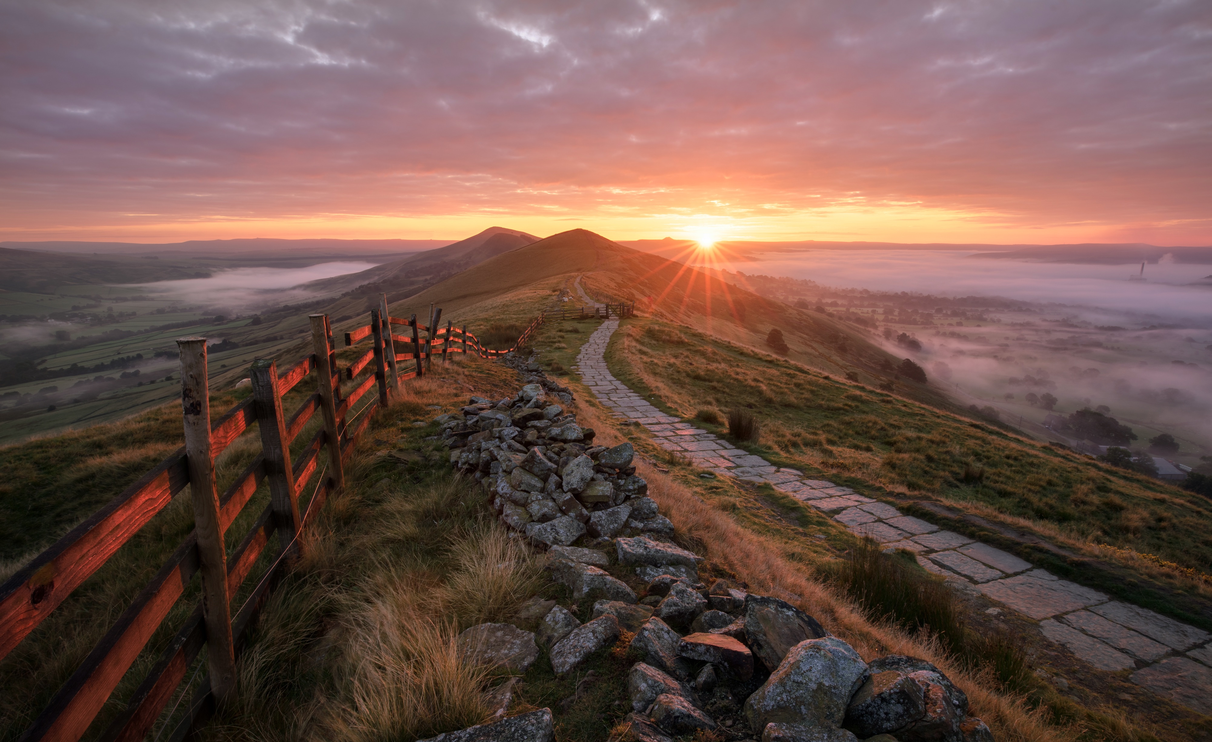 Sunrise and mist at Mam Tor in the Peak District.