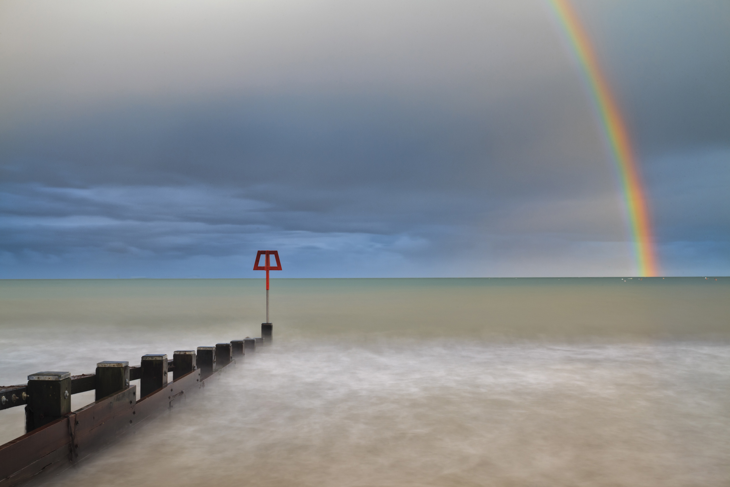 Spring is the season for sunshine and showers. Rainbow over Swanage Bay.